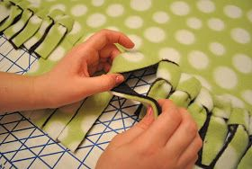 Another way to tie knots on no-sew fringed-edge blankets. Still a knot, & uses a longer fringe, so I think I'd prefer one of the looping methods, but just want to include all the possible methods on this board.  That Village House: No-sew fleece blankets