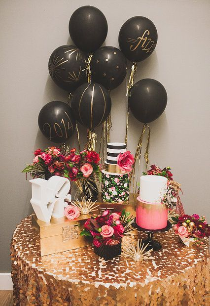 Glittery gold and black modern wedding cake table display inspiration