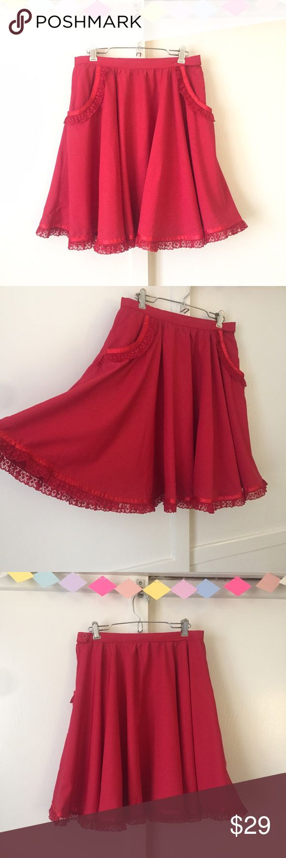 """Red Full Circle Lace Hem Skirt The Full Red Circle Skirt. This is a glorious full circle skirt with the prettiest lace hem! It has pieces of satin trimming that shine in the light as you spin around. Pair this beauty with your favorite stockings and booties to complete the look. No size tag, but would best fit a medium. See the last photo for details on the button closure with some loose stitching. It's on the inside, so it doesn't show at all when you're wearing it.   Waist: 28"""" with…"""