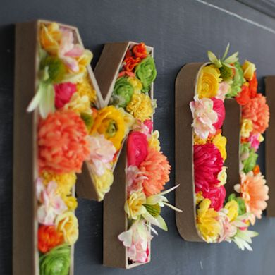 Cardboard monograms turned into flower arrangement