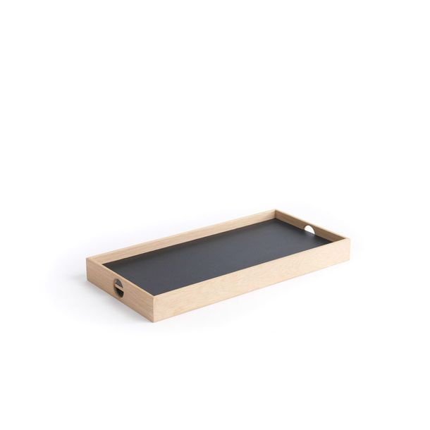 A reversible tray framed in solid natural oak that has a black surface on one side and a white surface on the other. Ideal for serving.    Made in Denmark by The Oak Men and selected by Waremakers.