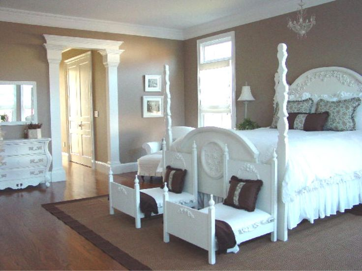 dog bedroom. Dark  rich walls with white furniture and bedding Minus mini beds at foot Bright poster bed matching dresser Clean simple ele
