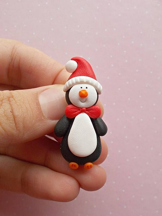 Christmas brooch created from polymer clay without molds or forms, with a lovely penguin. A perfect gift for winter holidays. The lenght of the brooch is 4.3 cm. It is not heavy. Suitable also for children.  ❀ Because i make everything by hand, the item you receive may differ slightly than