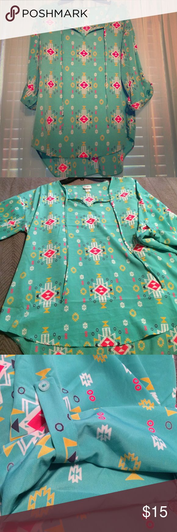 The Buckle Daytrip Aztec Blouse. This Aztec Blouse is super cute! It's longer in the back. Colors are Turquoise, Hot Pink, White, Yellow and Purple. Only worn a handful of times! In great condition! Daytrip Tops Blouses