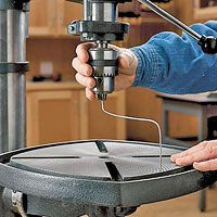 set your drill-press table 90° to the bit