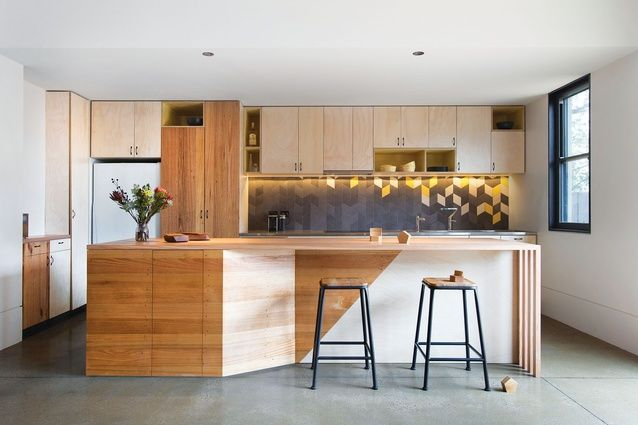 Geometric tiling on the kitchen splashback provides an accent to the otherwise neutral colour palette.