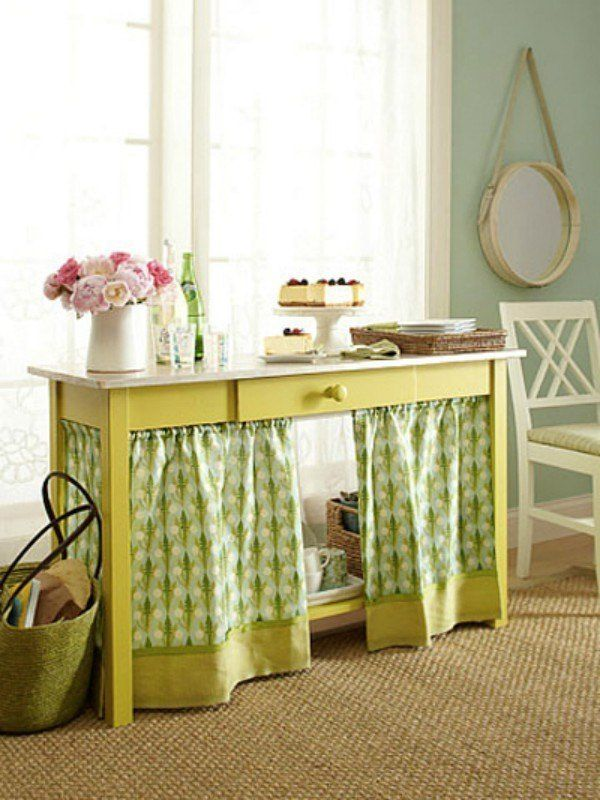 An antique wooden desk? So cute! A million chords and cables running underneath it? Not so cute. Use tension rods to make an impromptu curtain to hide your technology.