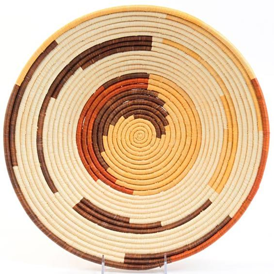 Handwoven out of Banana Stalks and Raffia, these Ugandan baskets are nicely woven with large, even coils.