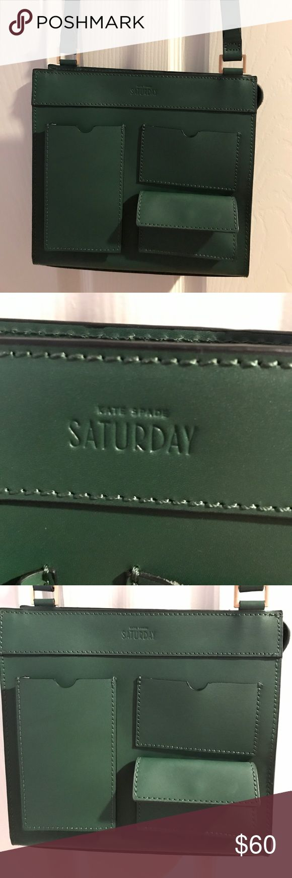 Kate Spade Saturday Leather Bag Dark Green Leather Kate Spade Saturday Bag, was just stored in the cabinet, small scratches but not noticeable (please see pictures for reference). It has 3 pockets in front. For the phone pocket, you can put your ip6 or ip7 but it would be tight but still fits. Adjustable handle Kate Spade Saturday Bags