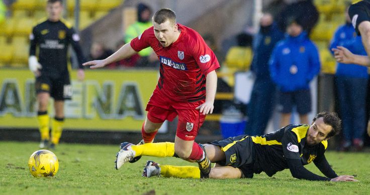 Queen's Park's Jamie McKernon is brought down during the Ladbrokes League One game between Livingston and Queen's Park.