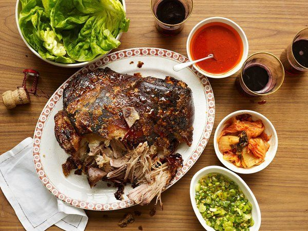 NYT Cooking: This is a recipe to win the dinner party sweepstakes, and at very low stakes: slow-roasted pork shoulder served with lettuce, rice and a raft of condiments. The chef David Chang serves the dish, known by its Korean name, bo ssam, at his Momofuku restaurant in the East Village and elsewhere. He shared the recipe with The Times in 2012. Mr. Chang is known as a kitc...