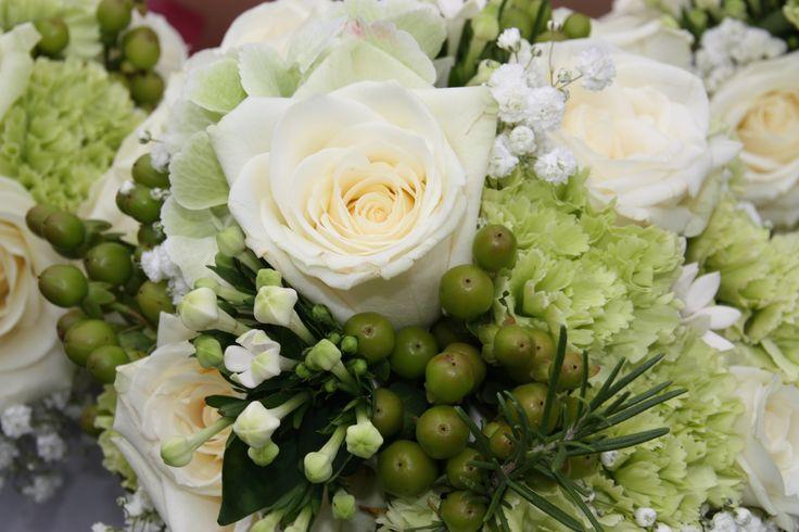 Bridal design of Avalanche rosa, hypericum condor, dianthus, bouvardia, gyp, rosemary and hydrangea