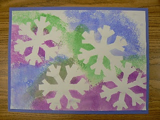 The students put a snowflake die cut on a piece of white construction paper and then sponge painted over the top with warm or cool colors. When they were finished they removed the snowflake.