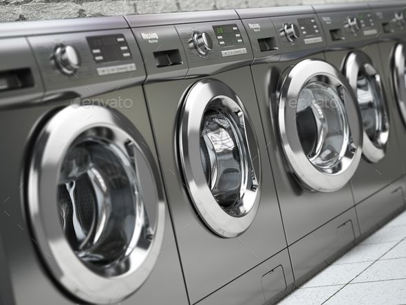 Row Of Washing Machines In A Public Laundromat Commercial