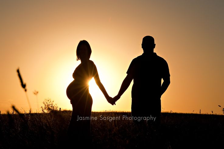 Gorgeous maternity silhouette at sunset