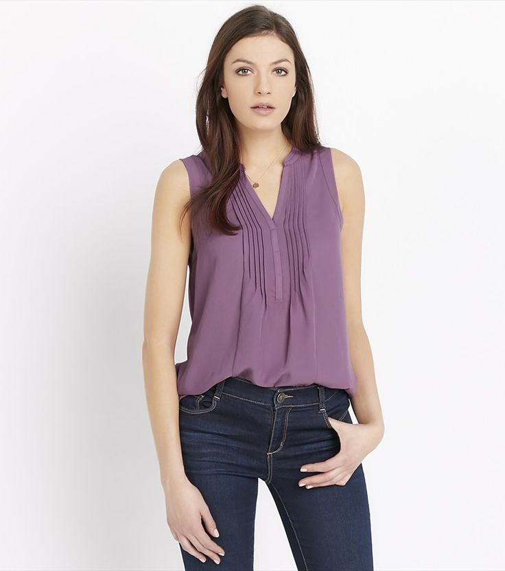 More pleats, if you please. This stunning blouse features unique front pleats, a flattering open neck and the perfect relaxed fit.