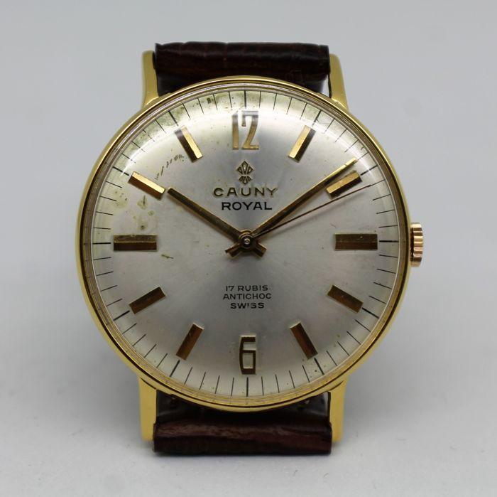 Cauny Royal - mannen horloge-1965  Merk: CaunyModel: RoyalMovement: Mechanical hand-wondKaliber: AS-ST 1950/51Behuizing:-Verguld metaalKast staat: zeer goedCase diameter: 34 mm (excl. kroon)Kiezen: Enkele tekenen van slijtageCrystal: Zeer goedKroon: Zeer goedBandje: Leer nieuwRiem gesp: vervangingBand breedte: 18 mmTotale lengte: 23 cmBeoordeling (0-10): 9Houd er rekening mee:Bevat geen originele doos.Bevat geen documenten.Verzekerde verzending via FedEx.Op uw adres afgeleverd overal in de…