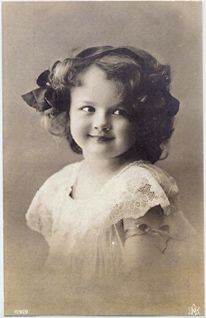 This vintage photo reminds me of my niece Sarah.  Mischievous look in her eye maybe...