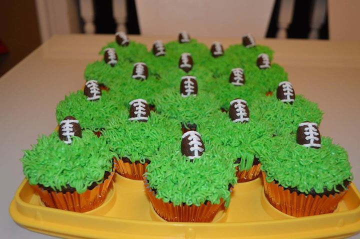 Foot ball cupcakes.  The footballs are chocolate Easter eggs.