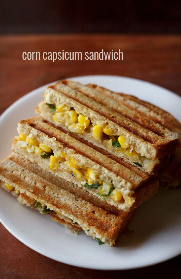 sweet corn capsicum sandwich recipe with step by step photos - easy recipe of a grilled corn capsicum sandwich.    sandwiches are loved at home. our favorite is always the mumbai veg sandwich, but on occasions i