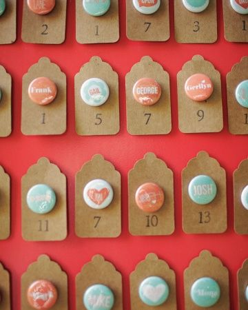Button Escort Cards This is a really neat idea for the escort cards! Something different and fun! We could attach them to a fabric covered bulletin board.