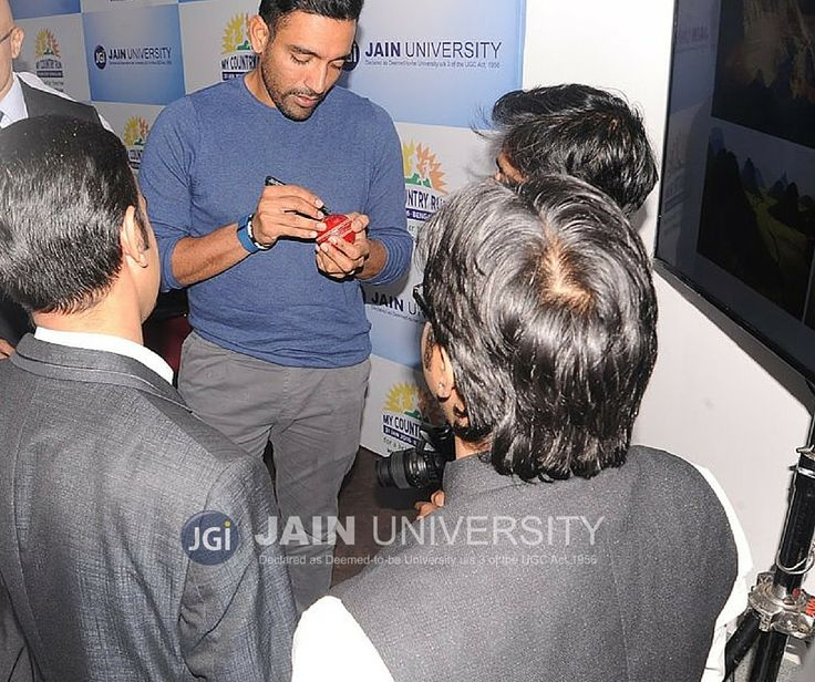 Cricketer Robin Uthappa who plays for Kolkata Knight Riders in IPL is a Jain University alumnus. He is seen giving autograph to his fans in this pic.