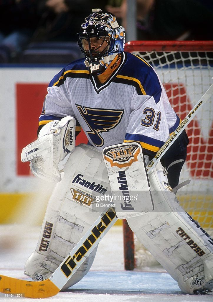 goalie-grant-fuhr-of-the-st-louis-blues-defends-the-net-during-an-nhl-picture-id114944854 (723×1024)
