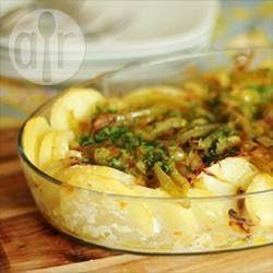 Foto da receita: Bacalhau com batata ao forno