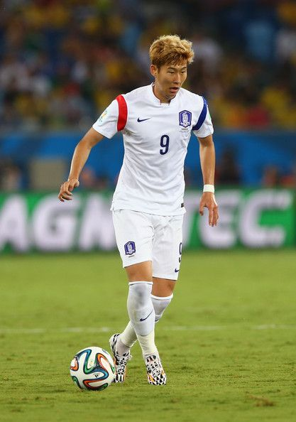 Son Heung-Min Photos - Son Heung-Min of South Korea controls the ball during the 2014 FIFA World Cup Brazil Group H match between Russia and South Korea at Arena Pantanal on June 17, 2014 in Cuiaba, Brazil. - Russia v Korea Republic: Group H