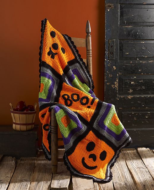 "If you're decorating for Halloween, make sure you have this crochet throw to complete your décor! The funny pumpkin faces are combined with the ""BOO!"" center square to give everyone happy memories of this fun season."