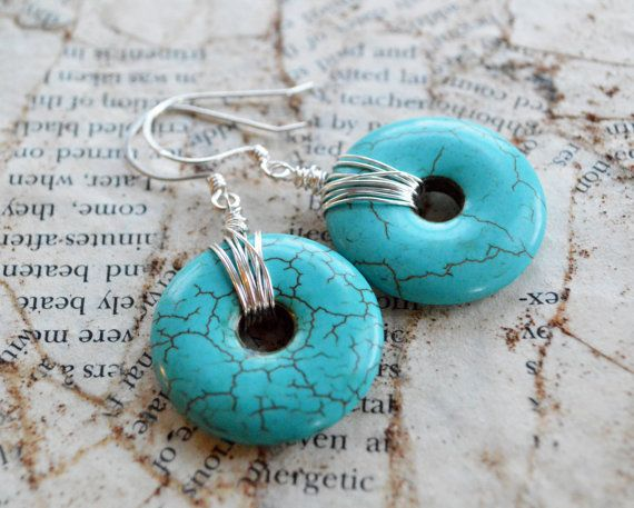 These earrings are simple and bold! They are made from bright turquoise howlite, doughnut shaped gemstones. There is a sterling silver filled wire wrapped around the middle of the stone. The sterling silver filled earring hooks are hand formed, and skillfully crafted by me. This makes for a very high quality hook that is larger, and far superior to typical earring hooks. The earring hook is over-sized and adds a lot of visual interest to the design of the earrings.        Measurements…