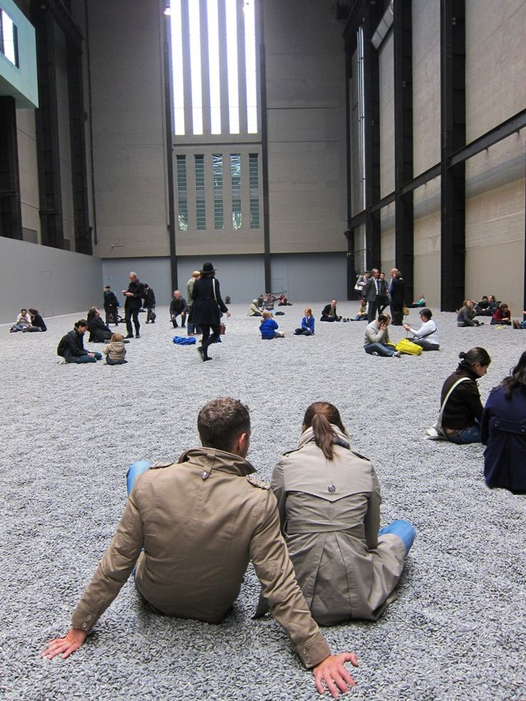 """Hanging out in 100 Million hand-painted porcelain sunflower seeds created by Chinese laborers (artist Ai Weiwei's installation """"Sunflower Seeds"""" at the Tate Museum in London by artist Ai Weiwei. Photo, Mary Boone Gallery and video posted on ArrestedMotion.com"""
