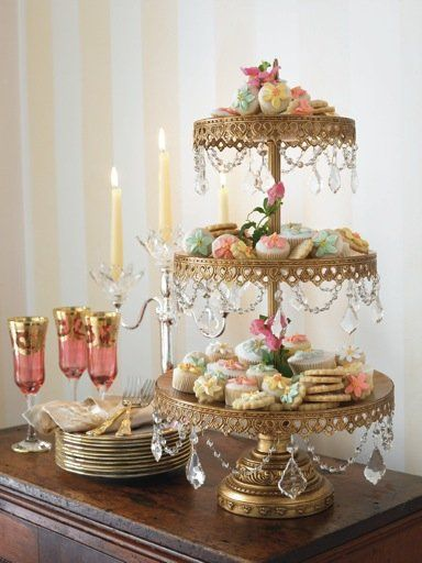 A golden cake stand to display treats. I love the gold with hints of rose and other pastels, and the crystals with the gold. Also love the glasses, I may have some heirloom ones we can toast from that are close to this.