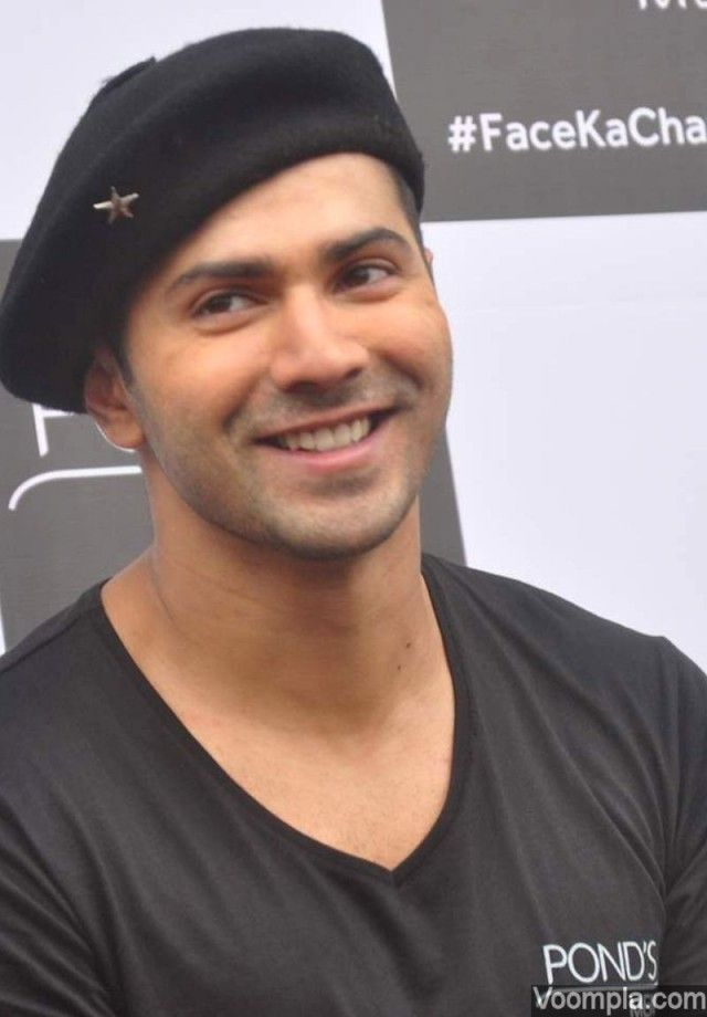 Bollywood hunk Varun Dhawan's cute smile is captured in this candid shot. via Voompla.com