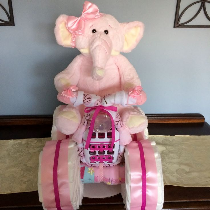 "Beatifully crafted diaper creations ranging from the original ""Diaper Cake"" to specialty items which include bassinets, castles, bikes and more."