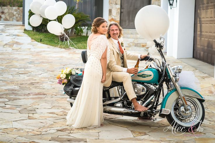 Julianne & Paul on their wedding day at Villa La Laguna! A Harley the perfect gift for our groom!