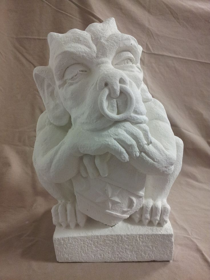 Gargoyle with shield that we molded out of white concrete of a client. One of our many concrete statues available for sale.