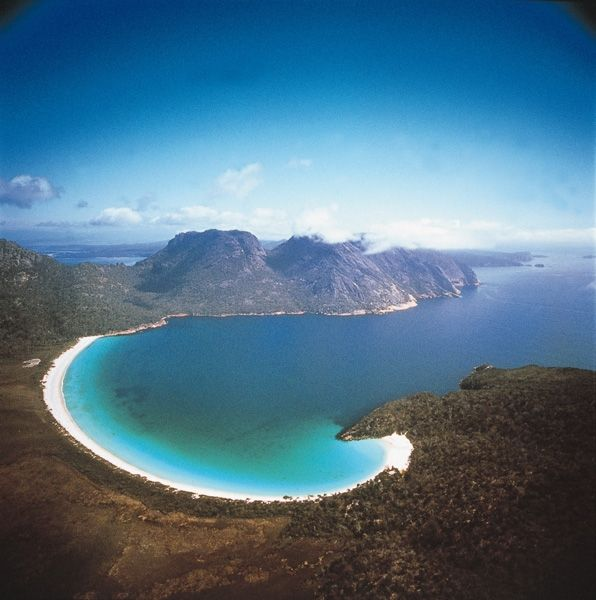 Wineglass Bay. Everytime we went camping at Coles Bay, we would walk to here and spend a day roasting on the sand. It was ALWAYS beautiful.