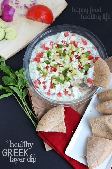 Healthy Greek Layer Dip - the perfect addition to any potluck, BBQ, or get-together this summer. www.happyfoodhealthylife.com