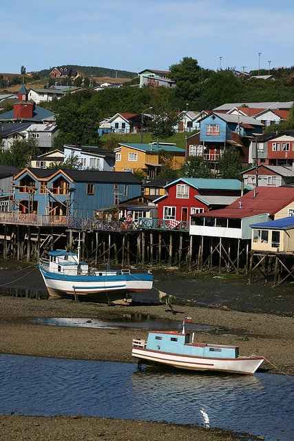 Palafitos (houses on stilts) tide's out in Chiloe Archipelago. CHILE