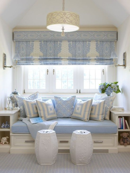 Pretty Roman Shade with Pelmet Box | Powder blue pillows and bench accent the style.
