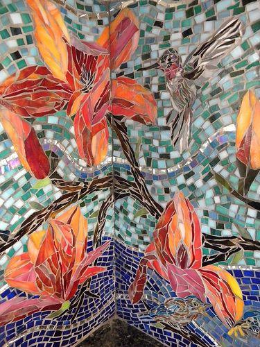 Mosaic hummingbird as part of kitchen backsplash.