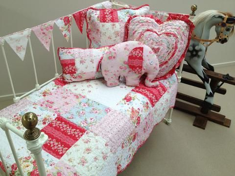 Emma Cot Quilt from the Lovely Linen Store.This gorgeous cot quilt features matching bunting and a assortment of matching decorator cushions. The perfect addition to your baby girls room! #LovelyLinenStore