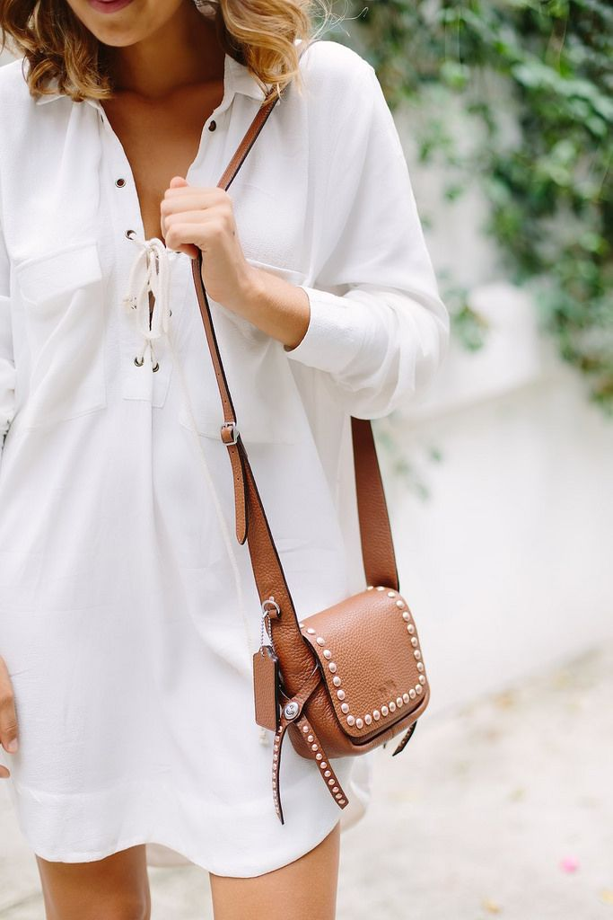 Tan bag and white dress a pair and a spare