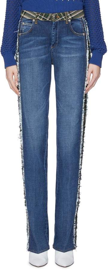 292c08be0d Outlined by frayed tartan plaid stripes, these jeans exhibit Sonia Rykiel's  eclectic take on the track trend. This pair will style well with a crochet  knit ...