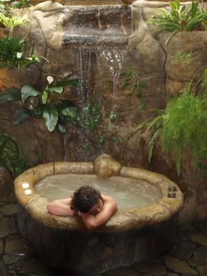 Sanctuary ... a stone spa bath at the Peace Lodge in Costa Rica. Photo: Shane Hudson