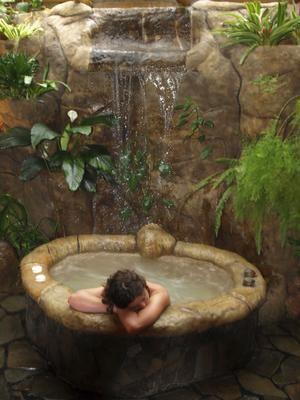 Sanctuary ... a stone spa bath at the Peace Lodge in Costa Rica. Photo: Shane Hudson