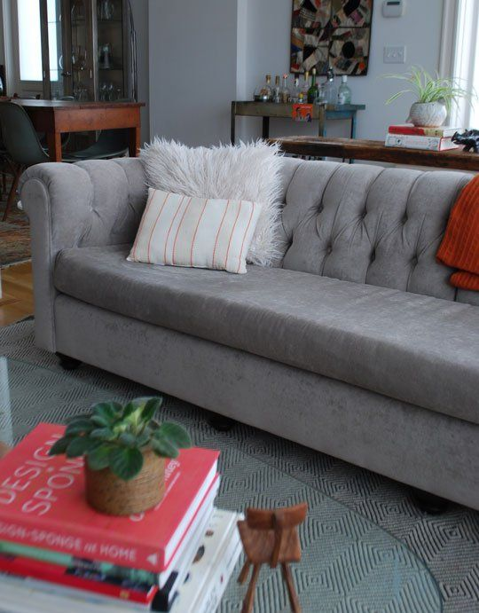The author took this ugly, leather, worn chesterfield and turned it into this beauty.  $40 for the sofa...$$$ on the reupholstering but so worth it and less than you'd spend to buy brand new.  The Ten Commandments of Buying Used Furniture
