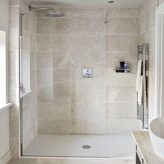 Neutral stone tiled shower room