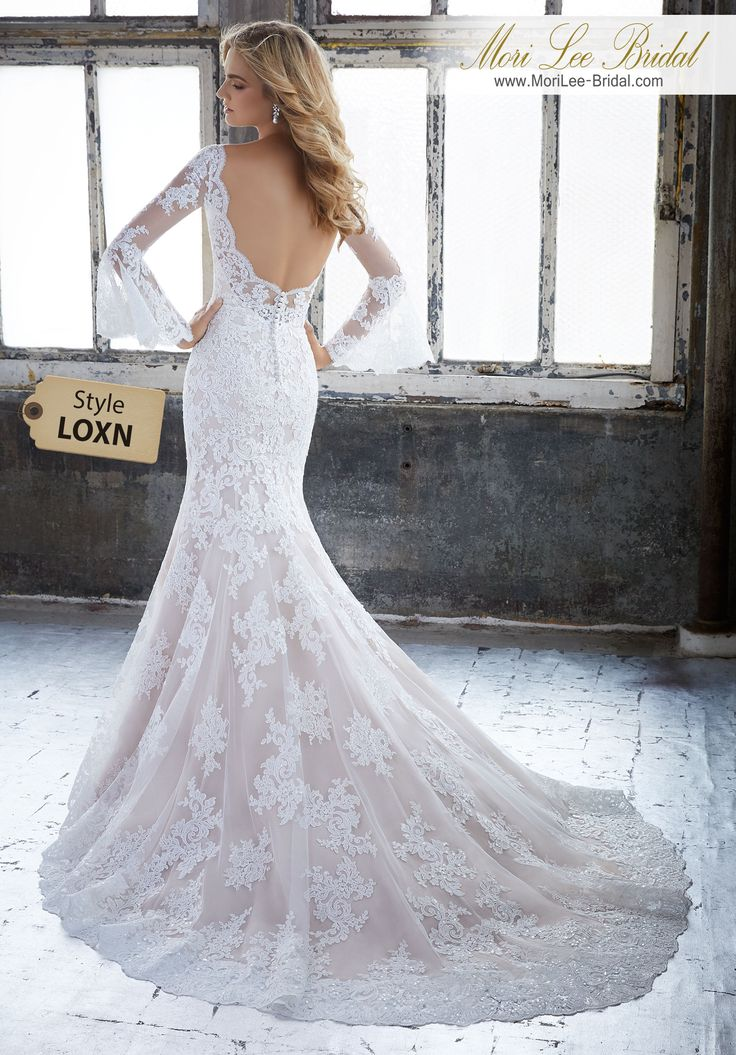 Style LOXN Kendall Wedding Dress Frosted Alençon Lace on Net Fit and Flare Gown Featuring Beautiful Poetic Sleeves and a Scalloped V-Neckline. A Scalloped Open back and Intricate Hemline Complete the Look. Available in Three Lengths: 55″, 58″, 61″. Colors Available: White, Ivory, Ivory/Rosé